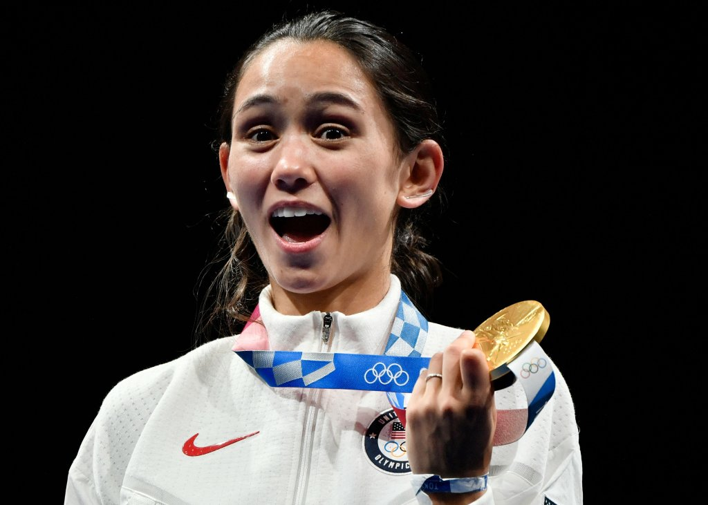 Gold medallist USA's Lee Kiefer celebrate on podium during the medal ceremony for the women's foil individual during the Tokyo 2020 Olympic Games at the Makuhari Messe Hall in Chiba City, Chiba Prefecture, Japan, on July 25, 2021.